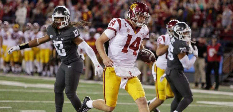 Southern California quarterback Sam Darnold (14) runs for a touchdown during the second half of an NCAA college football game against Washington State in Pullman, Wash., Friday, Sept. 29, 2017. Washington State won 30-27. (AP Photo/Young Kwak)