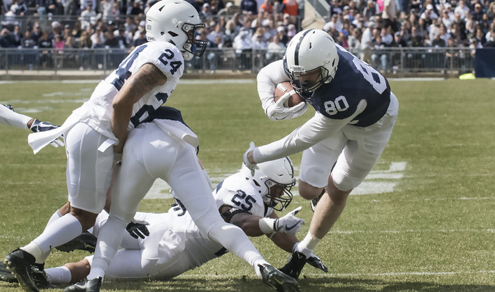 Tight end Danny Dalton (80) worked for extra yardage following a reception during game-action at the annual Blue White game April 21 at Beaver Stadium. Dalton's reception led the Blue Squad to their first touchdown of the afternoon.