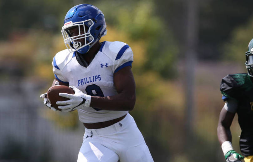Phillips' Academy's Jahleel Billingsley tucks the ball away and heads to the end zone after catching the Wildcat's first play from scrimmage for a touch down, September 16, 2017. Allen Cunningham / for Chicago Sun Times