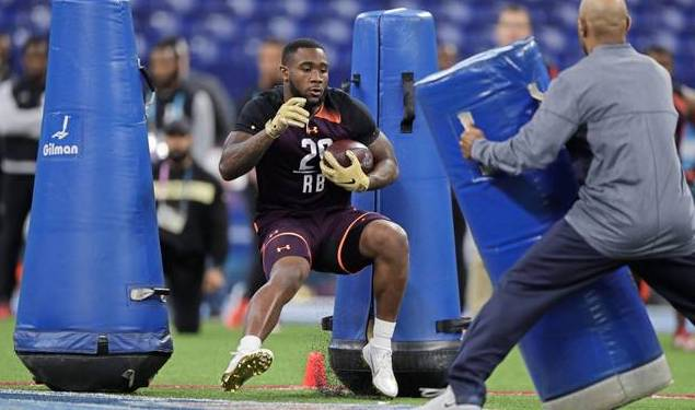 Former Woodland Hills and Penn State running back Miles Sanders runs a drill at the NFL Combine Friday, March 1, 2019.