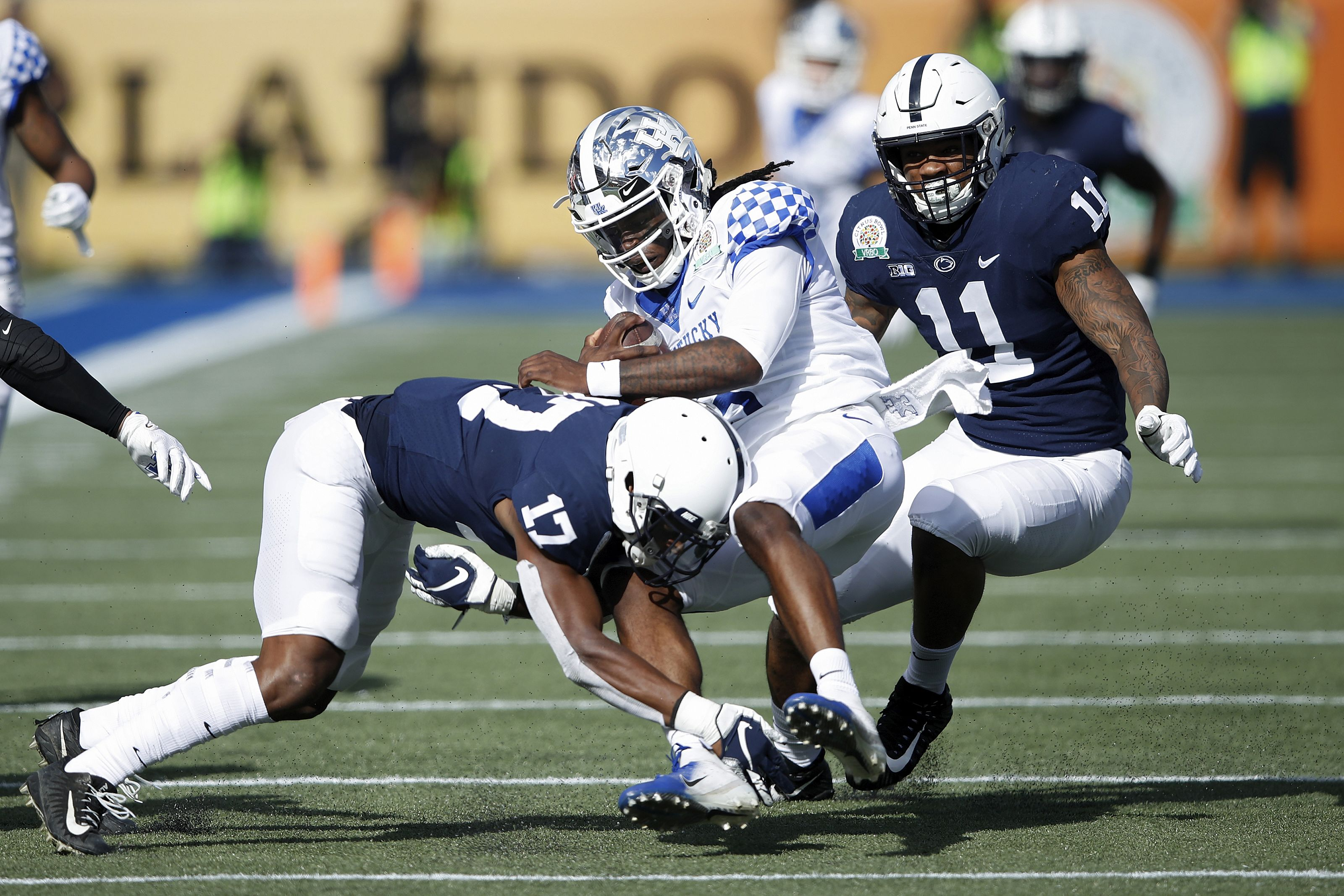 ORLANDO, FL - JANUARY 01: Garrett Taylor #17 and Micah Parsons #11 of the Penn State Nittany Lions tackle Terry Wilson #3 of the Kentucky Wildcats in the first quarter of the VRBO Citrus Bowl at Camping World Stadium on January 1, 2019 in Orlando, Florida. (Photo by Joe Robbins/Getty Images)